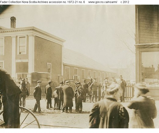 Recovered bodies from Titanic being brought to the Mayflower Curling Club, where a temporary morgue had to be set up.