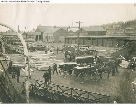 Transferring victims from CS Minia at Halifax Dockyard