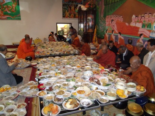 Monks serve lunch 5 minute before the nuns. Monks are eating after they completely give laypeople their blessing to reach nirvana.