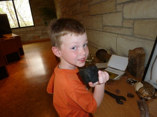 The New River Gorge Visitor Center has several museum artifacts. My six year old son is investigating a piece of coal at a discovery table.
