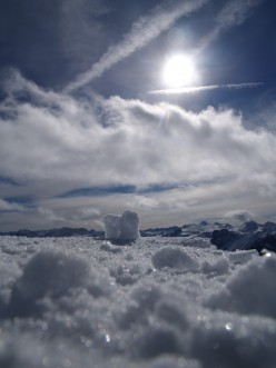 How is it that a cloud, though made up of water, which is a transparent substance, can hide the sun?