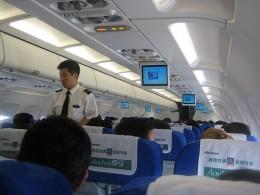 male flight attendant in a flight to Hong Kong