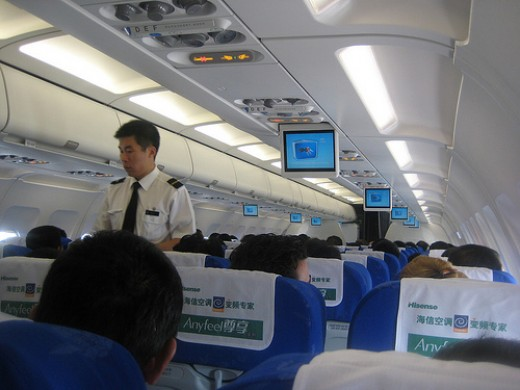 male flight attendant in a flight to Hong Kong
