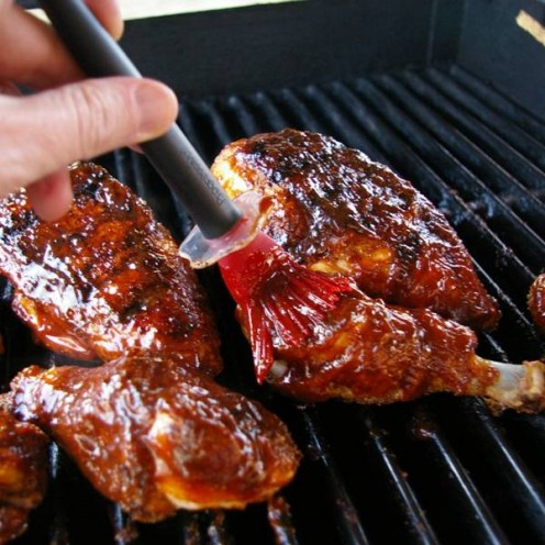 Putting Barbecue Sauce on Chicken