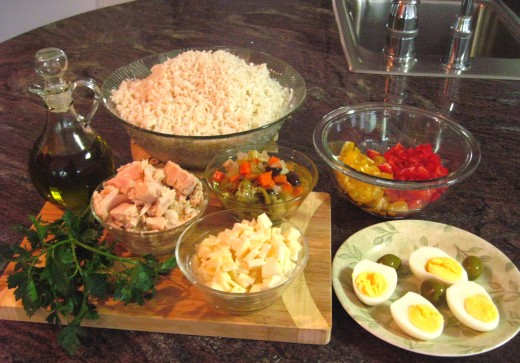 "These are the ingredients that I used for the rice salad in the picture above. The mixed veggies in the center are actually from a jar, an Italian product called ""Condiriso"" that contains a mix of carrots, olives, artichoke hearts, and peppers."