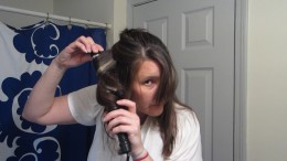 Wrap the hair around the curling iron barrel and pull it through...