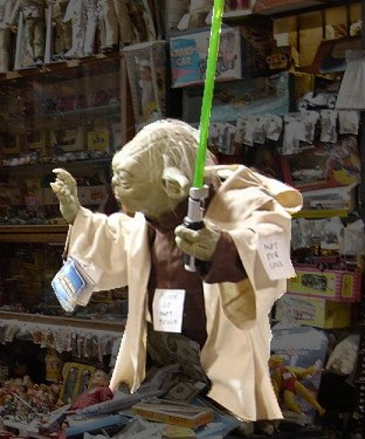 Yoda from Star Wars in a toy shop. One small body, big on miracles.
