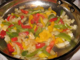 A bunch of sauteed veggies make a quick, easy and inexpensive addition to a simple bowl of pasta.