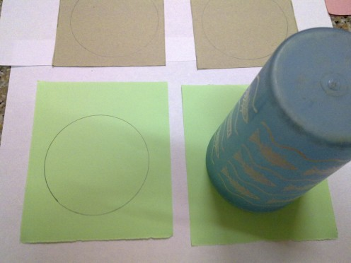 draw circle  with a plastic cup, the dimension depends on how big you want