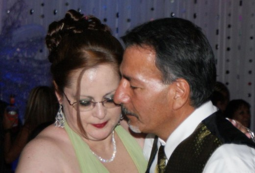 Geegee77 and hubby Chico slow dancing