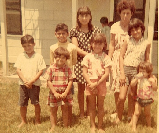 Geegee77 is the one with the bottle.......she was only 2....I am the one in the pock-o-dot dress, we didn't take many pics back then.