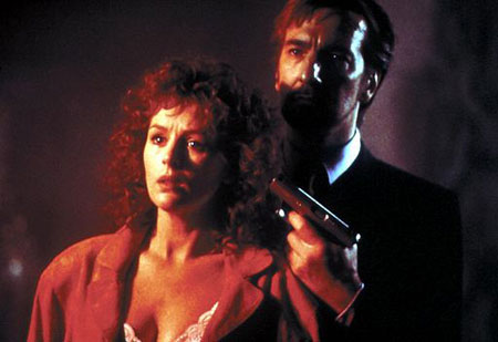 Die Hard Cast: Holly Gennaro McClane played by Bonnie Bedelia and Hans Gruber played by Alan Rickman in Die Hard (1987)