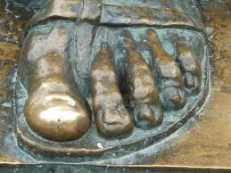 The massive sculptor is the work of Ivan Meštrović.   There are only 3 original Grgur Ninski's in the world.  People like to touch his big toe and make a wish :)