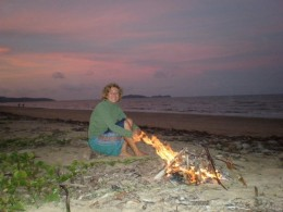 Romantic bonfire at sunset, enjoying the lovely colors of the light and sky, preparing myself for the quiet, deep dark night at Wonga Beach, Queensland, Australia.