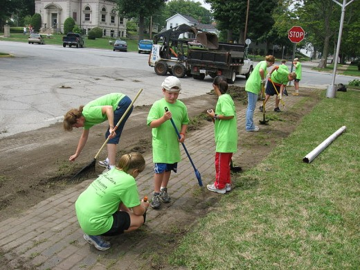 Kids volunteering their time to cleanup their neighborhood