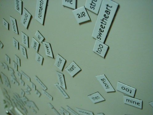 Assembling the words to create a poem.