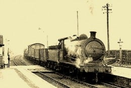 A J27 brings a Class K Freight, Mineral or Ballast train stopping at intermediate stations into a country station; from 1960 Class 9 Pick-up Branch Freight, Mineral or Ballast train