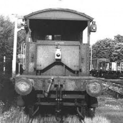 Tail end of an ex-SR 'Queen Mary' brakevan with triple lamp code