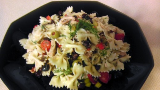 This pasta salad with tuna, tomatoes, and two kinds of olives will be a hit with family and friends.