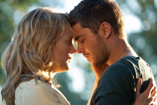 "Taylor Schilling and Zac Efron star as the reluctant lover in the film adaptation of Nicholas Sparks' book, ""The Lucky One"""