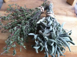 Dry herbs easily by tying a rubber band loosely around the stems and hanging upside down in a non-moist environment.