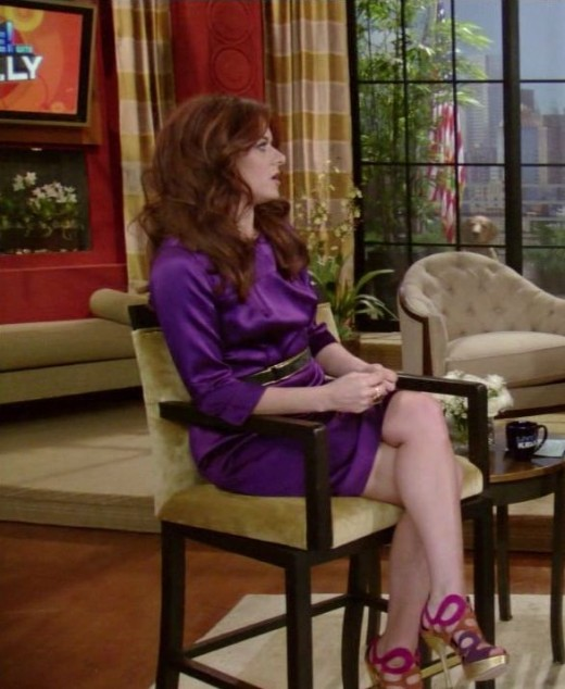 Debra Messing long legs crossed on Live! With Kelly