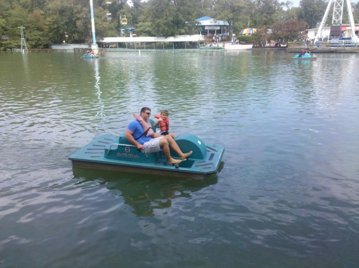Taking a spin around the lake in a paddle boat.