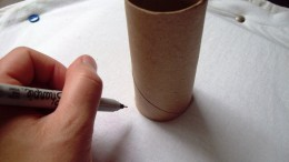 Draw a circle for the planet with a toilet paper tube.