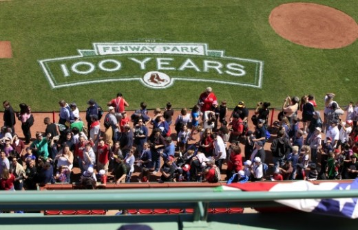 Red Sox Fans admire the field logo celebrating 100 years of Fenway Park!