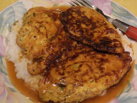 Vegetable Egg Foo Yung on bed of white rice