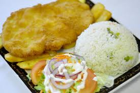 Milanesa de Pollo with a side of salad, fries and rice.