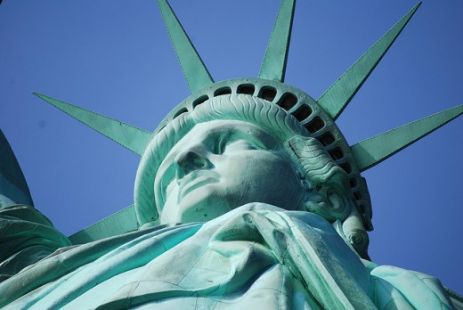 """""""Give me your tired, your poor, Your huddled masses yearning to breathe free"""","""
