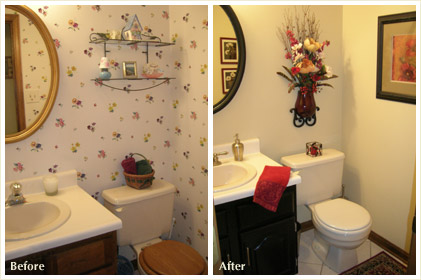 Removing the fussy wallpaper and just adding a splash of red makes this bathroom more appealing. The mirror boarder was painted black to contrast wit the white walls.