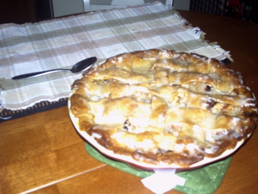 5. A-The ultiimate French Apple pie with raisins and sugar glazed top to the pie. Sliced criss crossed crust and glazed.