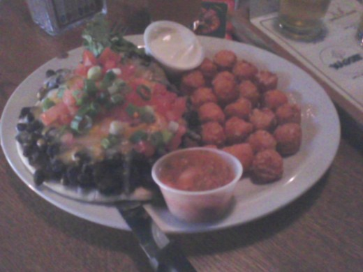 "Black bean open-faced pita sandwich and ""to die for"" sweet potato tots"