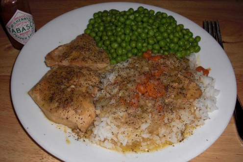 Pure Soulfood!  A hot plate of my smothered chicken breasts with rice and sweet peas!  Pass the cornbread and butter!