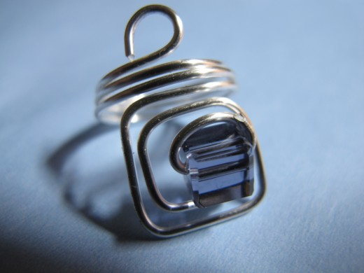 Square ring with purple crystal