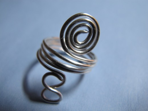 Spiral ring with infinity symbol