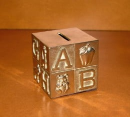 A retro bank for children that is a classy alternative to the piggy variety.