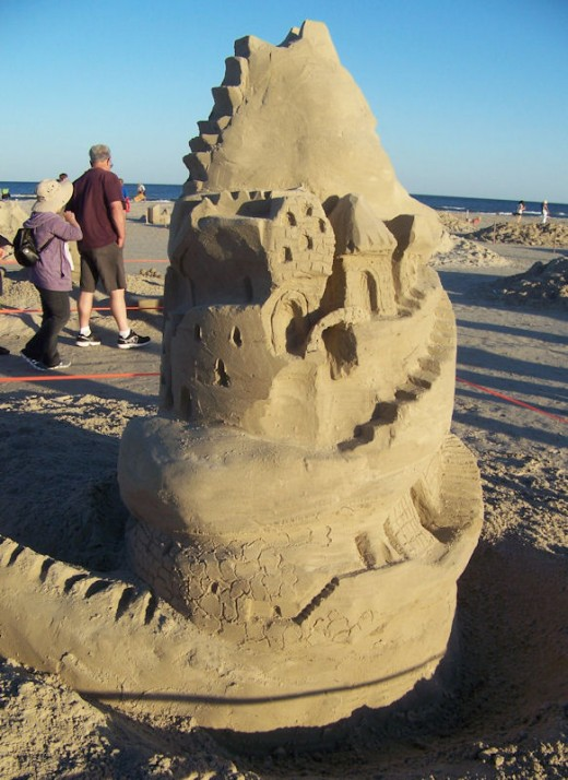 Build something from sand and put your subjects around it.