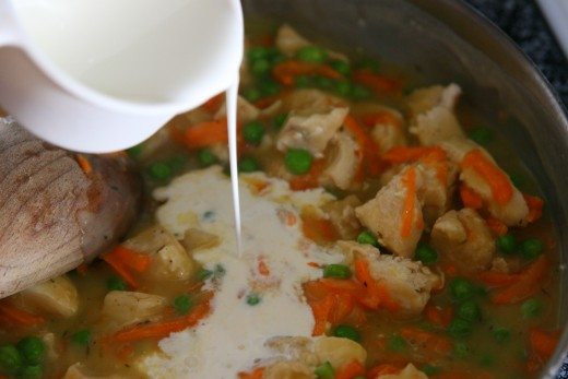 Add the cream to the broth and chicken mixture.