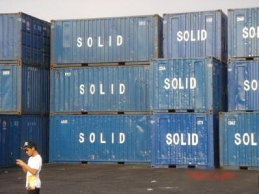 "Container vans that has ""SOLID"" written on it in Manila Harbor"