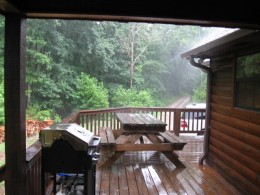 Even if it's raining you can sit in the hot tub (photo taken from hot tub) and enjoy the view from the protection of the covered deck.