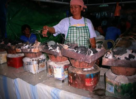 """Cooking """"bibingka"""" or rice cake from glutinous rice. Yum!"""