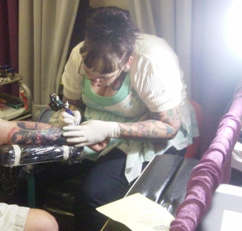 A woman 39 s first tattoo for Little johns tattoo greensboro nc