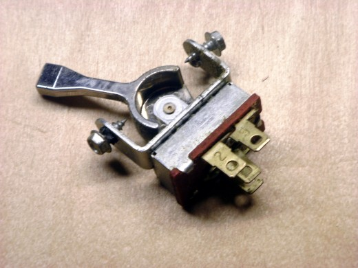 This toggle switch has 4 positions, including off; the line wire can be connected to any of 3 loads, one at a time or none in the off position.  Wires must be soldered into place.