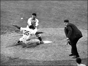 Berra slides safe into home.