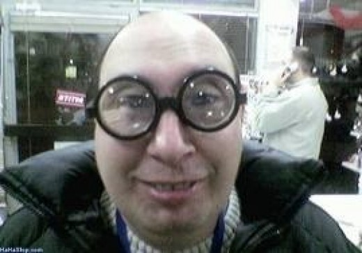 Man with coke-bottom glasses