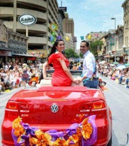 Downtown San Antonio, Mayor Julian Castro and his wife ride in the Battle of Flowers Parade 2012.