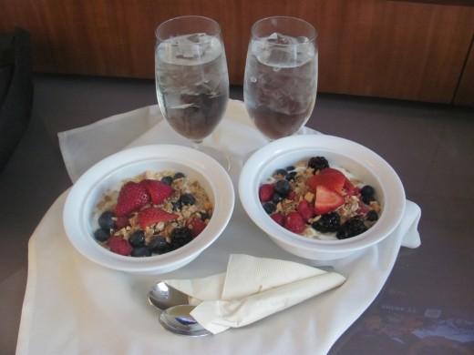Enjoy yogurt topped with granola and fresh fruit!